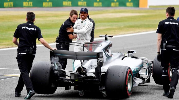 Lewis Hamilton takes pole position